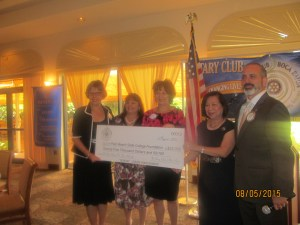 Rotary Pres. Spencer Siegal presents check to Palm Beach State College, Dr. Russell and staff