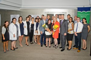 Dr. Stuart Markowitz, Waterstone GM Roseann Grippo, Co-Chairs Bonnie Kaye, & Jon Kaye with Charles E. Schmidt College of Medicine students at White Coats-4-Care