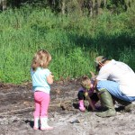 Volunteers planting cypress trees at the National Lands Day event