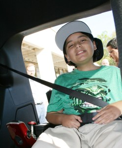 Damarius Roman is all smiles in his new wheelchair-accesssible van.