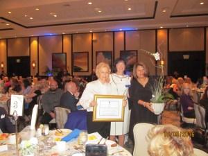 Elaine Wold receiving an award.