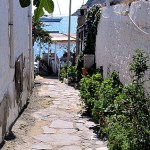 Gumusluk cobbled street white walls and bay, Turkey
