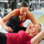 woman-working-out-with-trainer