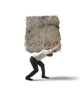 21139668 - concept of stress of a businessman with a big rock