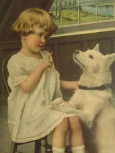 Little girl scolding puppy
