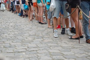 People standing in line illegal immigration analogy