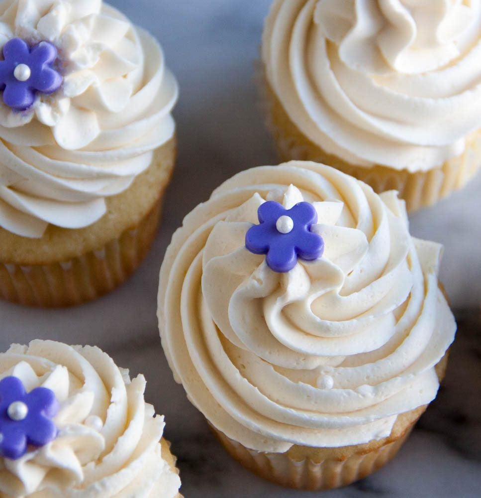 Perfect Vanilla Cupcakes every time. And topped with the fluffiest vanilla buttercream frosting ever!