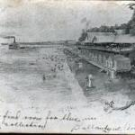 This undivided back postcard shows the bathing beach and bathhouses.