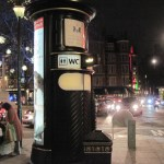 A phone-booth sized loo at Sloane Square. Note that the building in the background looks eerily like the Circus.