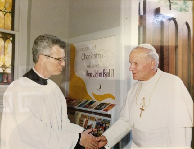 Our pastor, Leigh Lehocky, welcomes Pope John Paul II to St. Peter's on Sept. 11, 1987.