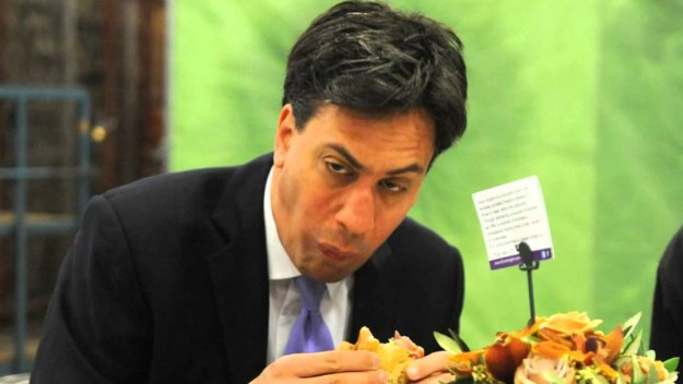 A penchant for awkwardness: Labour leader Ed Miliband having a spot of bother with a bacon butty.