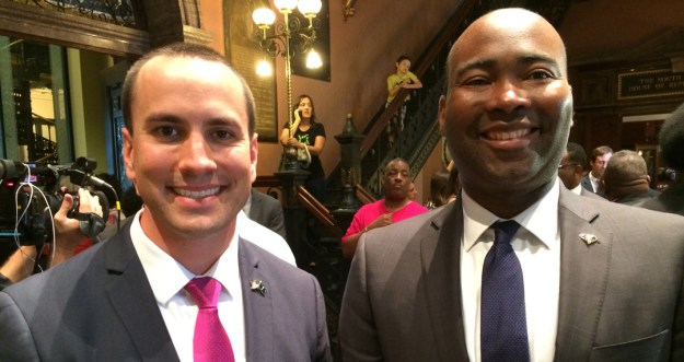 Jaime Harrison, right, standing shoulder-to-shoulder with the GOP's Matt Moore.