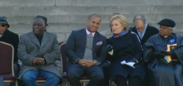 Hillary Clinton sitting on the COLD State House steps this morning with Todd Rutherford, awaiting her turn to speak.