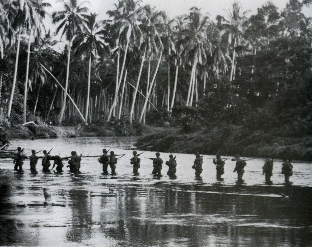 Guadalcanal: A U.S. Marine patrol crosses the Matanikau River in September 1942.