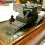 This was Burl's entry in the competition. It's a scene from the border conflicts between the Soviets and the Japanese in the late '30s. The water the vehicle is bogged down in took 8 layers of acrylic. Note the ripples.
