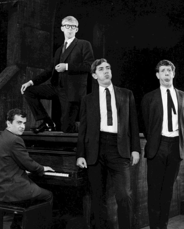 "Moore (at left, at keyboard) et al., in 1963, during their ""Beyond the Fringe"" days..."