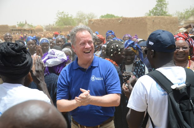 Visiting as head of the World Food Programme, David Beasley is welcomed by the villagers of Koundougou, in Burkina Faso.