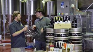 Shane Welch (right) shares a beer with Nomad Brewing's Brooks Caretta in the new Brookvale brewery