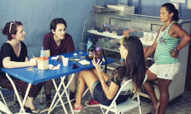 Talking to Isabel, a restaurant owner in the Alemao, with Emmanuel and Aline