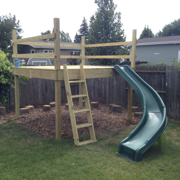 Diy kid 39 s play platform and jumping stumps for Diy play structure