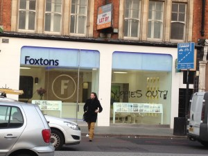 'Yuppies out' seen written on Foxtons, Brixton Road, picture by Kaye Wiggins