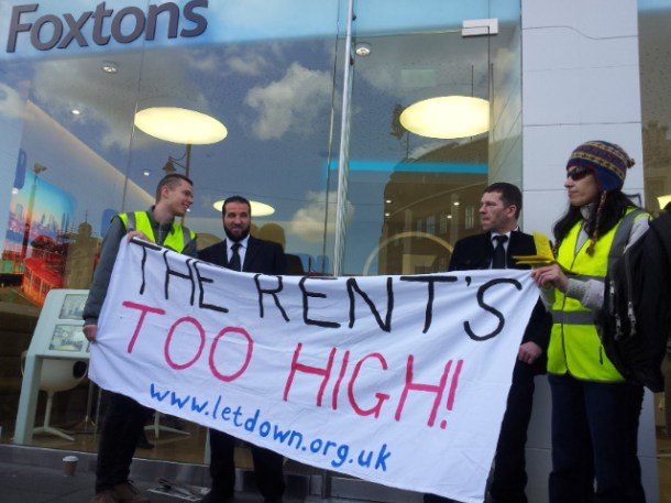 Protesters and security guards outside Foxtons