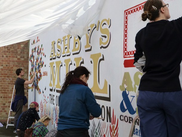 Volunteers paint the mural in Windmill Gardens last weekend. Picture by Nick Weedon on Flickr