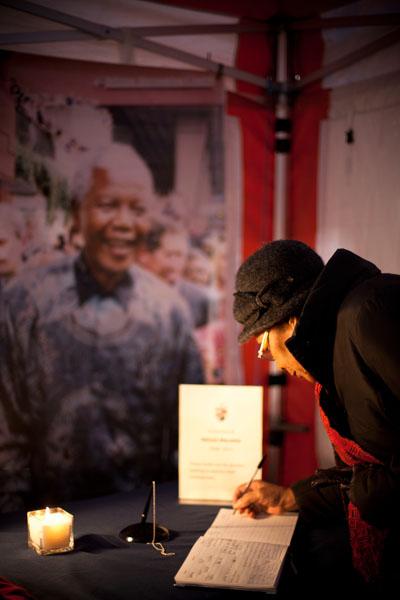 Mandela signing book