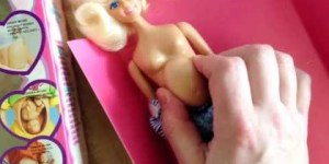 Early 90s Barbie-ish mommy doll features a spring loaded baby inside