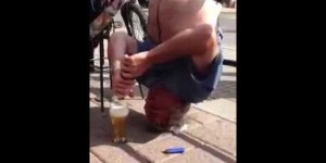 Old man chugs beer upside down