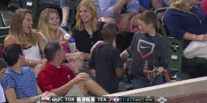 Kid catches foul ball, hands it to chick behind him, morphs into world's biggest PIMP
