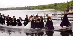Wedding Party Poses for Picture on Dock, Everyone Gets Wet