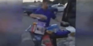 Guy films Walmart shoplifter putting cart full of stuff in his car before driving off