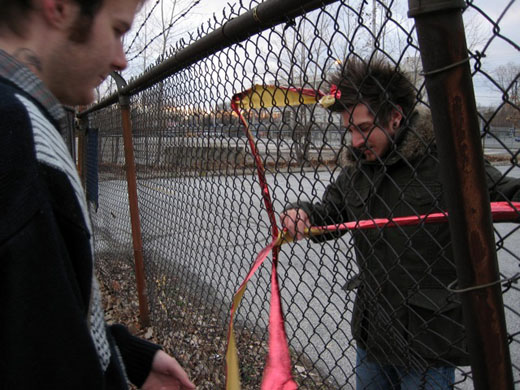 Steven and Justin work on ribbon with the fence