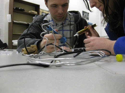 Josh and Michelle try to clean up some of the solder