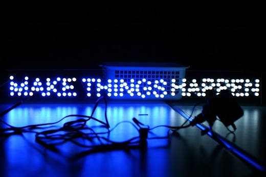 MAKE THINGS HAPPEN, the sign lit up
