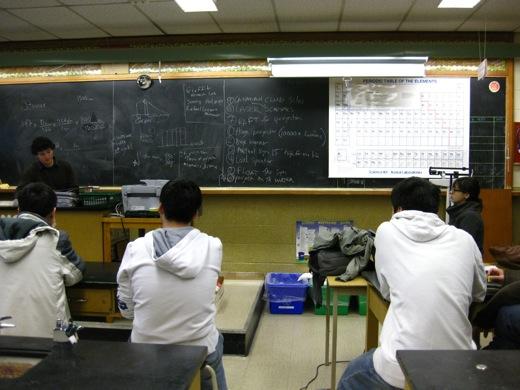 physics club, brainstorming on the chalkboard