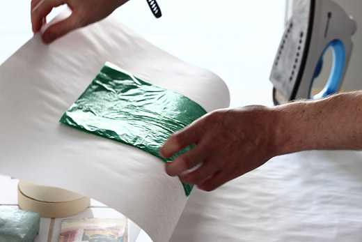 green bag under the iron