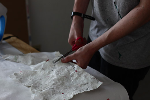 Steven cuts plastic bags