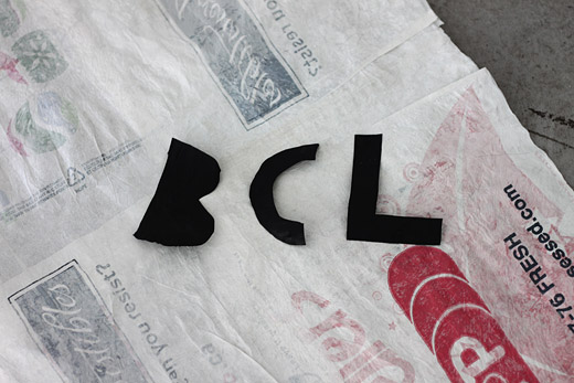 BCL in garbage bag letters