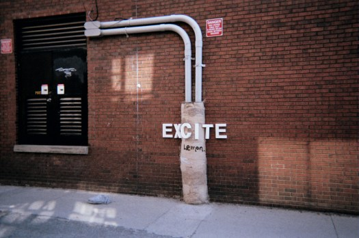 Documentation with single-use cameras: Putting letters up in city spaces (5)