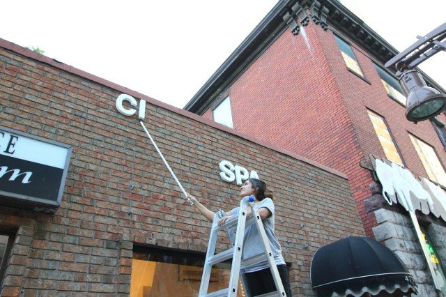 Installing some signage on the exterior wall of CIVIC SPACE (6)
