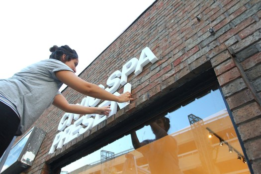 Installing some signage on the exterior wall of CIVIC SPACE (5)