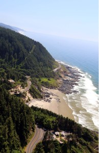View of Oregon Coastline with Route 101 Etched into Hill