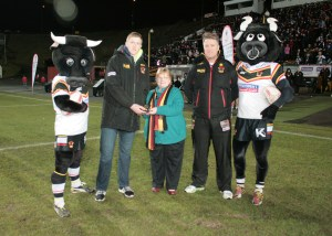 Liam Kirk receives March Player of the Month award from BullBuilder Board member, Jen Bennison