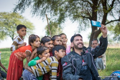 mragendra chaturvedi posing with kids of pagara, during the bulleteer's ride to pagara dam, gwalior