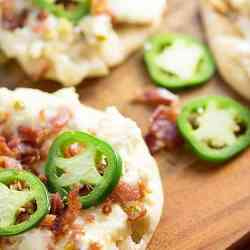 Jalapeno Popper Dip spread on flatbread! Such an easy snack and probably the most perfect football food ever!