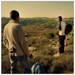 The planned separation wall has been on hold since Israeli activists from the town of Tsur Hadassah (in the background) have appealed to Israeli courts warning the wall will have disastrous consequences for the crops and springs of the village. Palestinian workers try to cross into Israel in order to work.