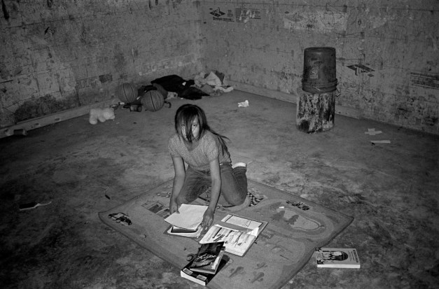 Doing homework in a cold, unfinished basement during winter, Oglala, Pine Ridge Reservation. (2010)