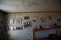 Photographs of priests, nuns and students decorate the walls of the rectory of Fort Chipewyan's former Residential School. The painful legacy of Canada's Indian Residential System is still felt in Fort Chipewyan.